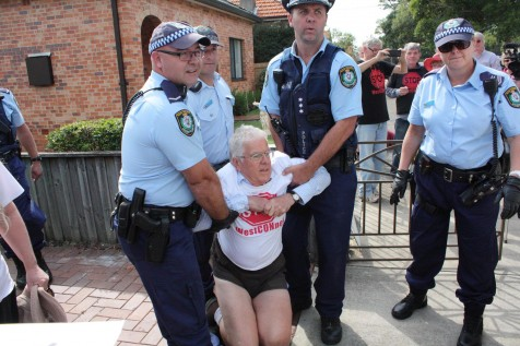 Mr Holliday being carried out by police on Saturday. Source: Facebook